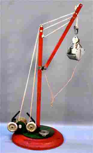 Unidentified vintage pressed steel clamshell crane toy