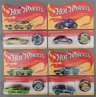 Four Mattel Hot Wheels 50th anniversary cars on blister