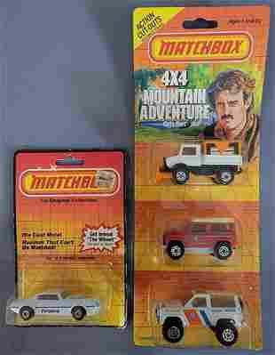 Group of four Matchbox vehicles on original Blister