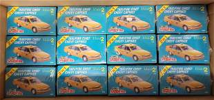 Twelve factory sealed Revell Taxi / Fire Chief Chevy