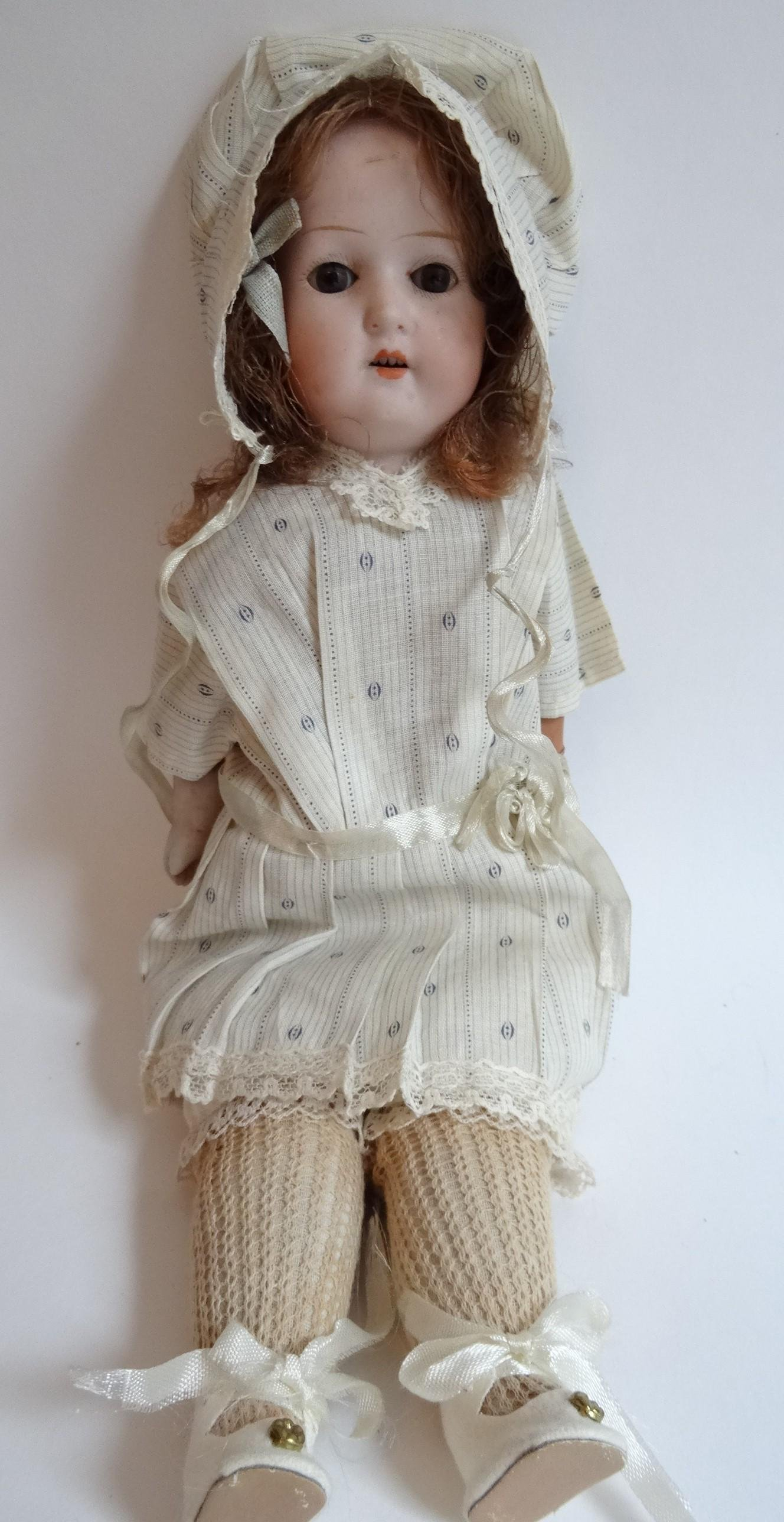 """12"""" Antique Bisque Pos. Heubach doll with leather body."""