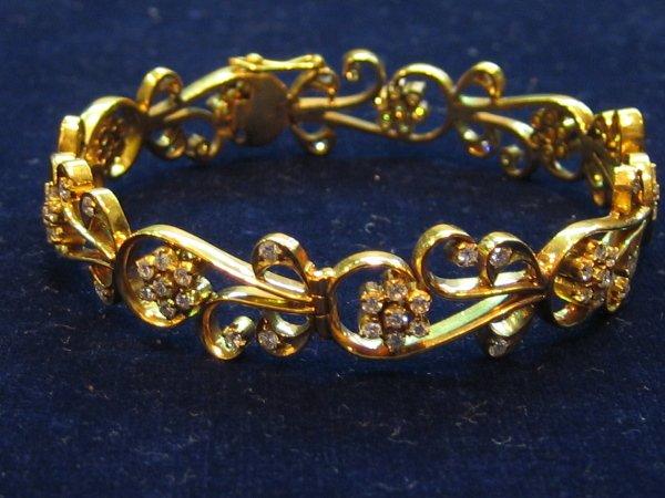 15: 1 PC 14KT GOLD DIAMOND BANGLE