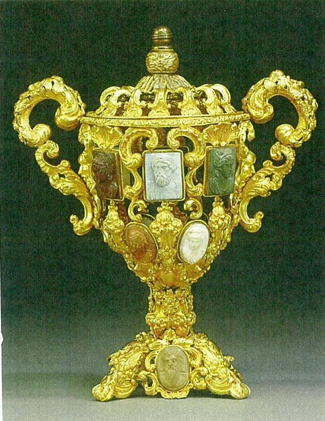 A Continental Embossed Gilt Metal Urn