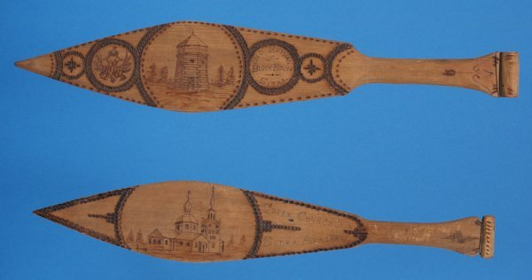 21: Two Tlingit Wood Paddles with Pyrographic Design of