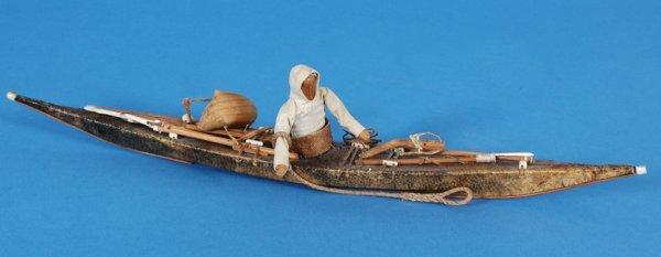 23: Inuit Kayak with Wooden Figure, Harpoon Implements,