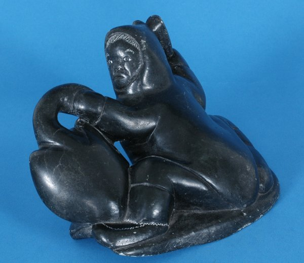 """8: Inuit Sculpture of a Hunter with Bird 9"""" W. 5 1/4"""" H"""