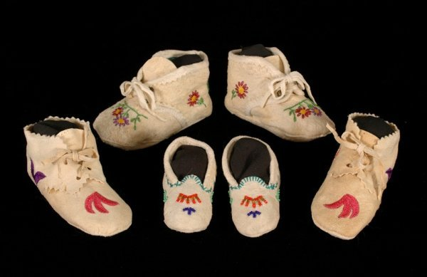 17: Three Pairs of Plains Embroidered Doeskin Baby and