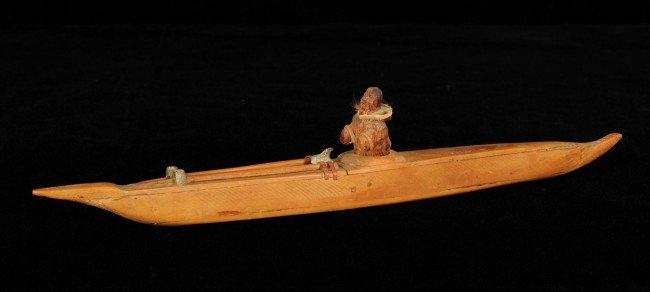 """24: Inuit Wood Kayak and Paddler 14 1/2"""" L. 2 3/4"""" H."""