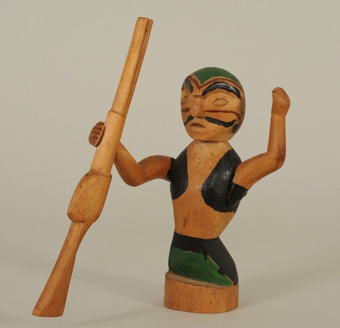 7: Carved Northwest Coast Figure of a Hunter with Rifle