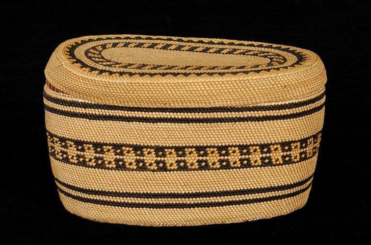 "8: Makah Lidded Basket with Geometric Design 6 1/4"" L."