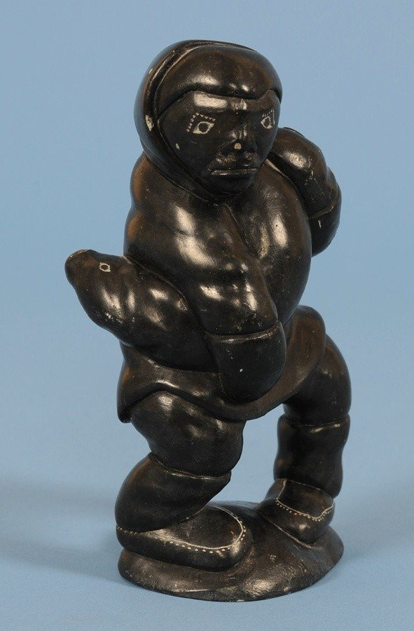 14: Fine Inuit Sculpture of a Hunter Holding a Seal, Si