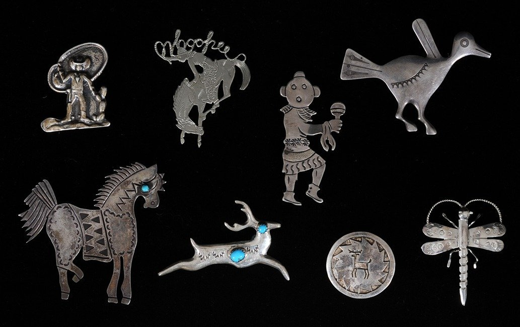 55: Seven Southwest Silver Pins and One White Metal Pin