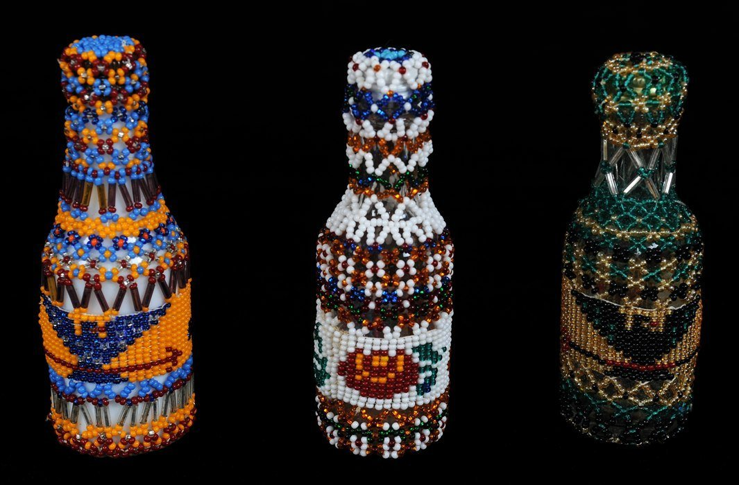 Three Nuu-chah-nulth Beaded Covered Bottles with Eagle