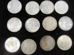 12 Silver Dollars, 11 are Morgans, 1 Peace Dollar