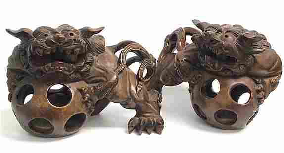 Antique pair of carved Chinese or Japanese wood foo