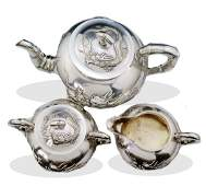 A set 20th century sterling silver carve dragon tea set