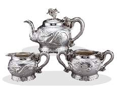 A set Qing Dynasty sterling silver carve dragon teapot