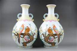 A PAIR OF FAMILLE ROSE DOUBLE-HANDLED BOTTLE VASES