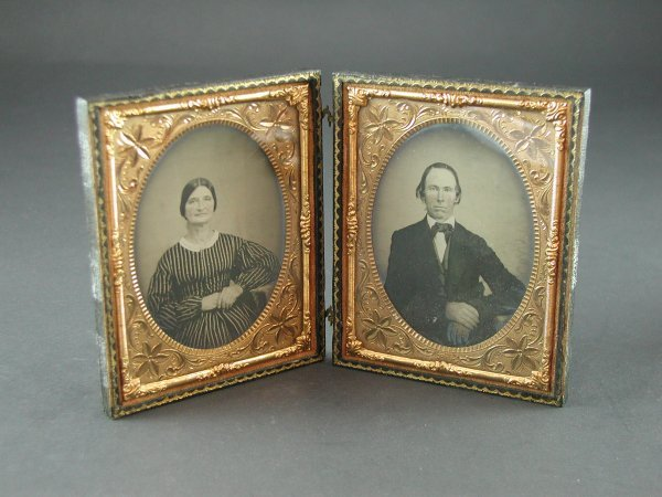1019: PAIR OF LEATHER FRAMED DAGUERREOTYPES