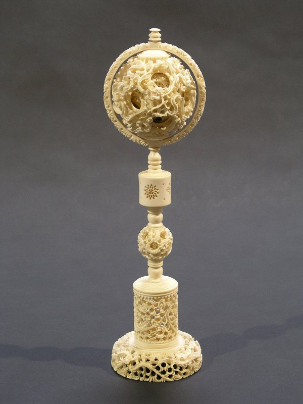 1003: CHINESE CARVED IVORY PUZZLE BALL ON PEDESTAL