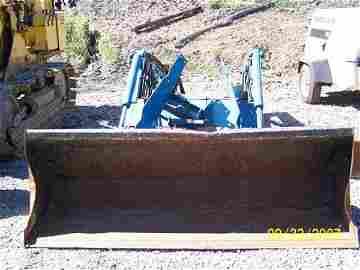 10: FORD 7411 FRONT LOADER ATTACHMENT