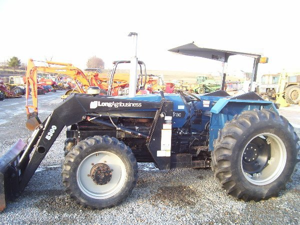 """21: LONG AGRIBUSINESS 680 DTC 4WD TRACTOR W/LOADER """"NIC"""