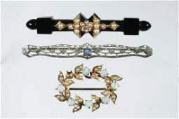 (3) BROOCHES