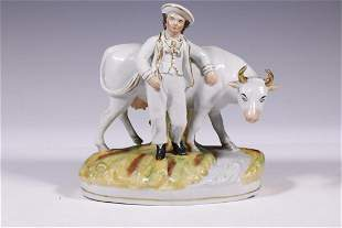STAFFORDSHIRE BOY AND COW FIGURE