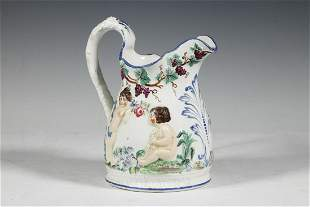 STAFFORDSHIRE PITCHER WITH PUTTI