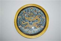A Chinese Silk Dragon Roundel
