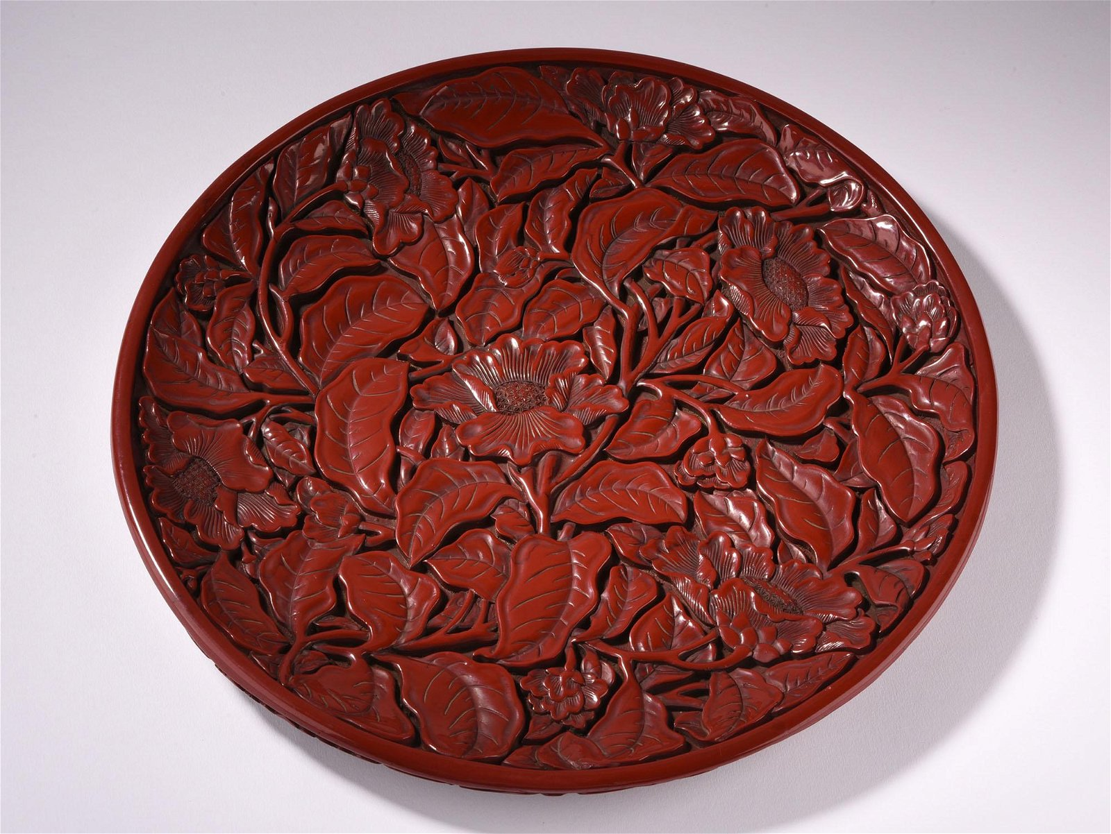 A CARVED CINNABAR LACQUER DISH, MING DYANSTY