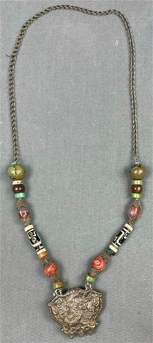 Necklace chain with dragon pendant. Probably Tibet,