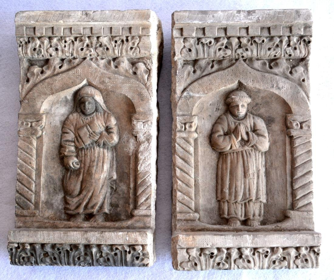Two early stone religious sculptures carved in relief,