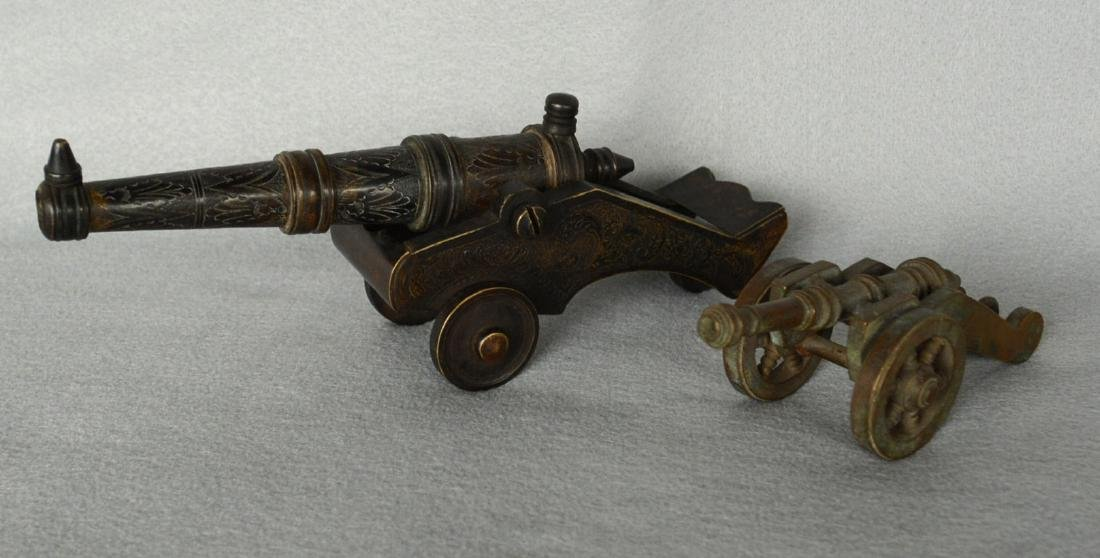 """Two bronze cannon models, 9.5""""L and 5.5""""L. The larger"""