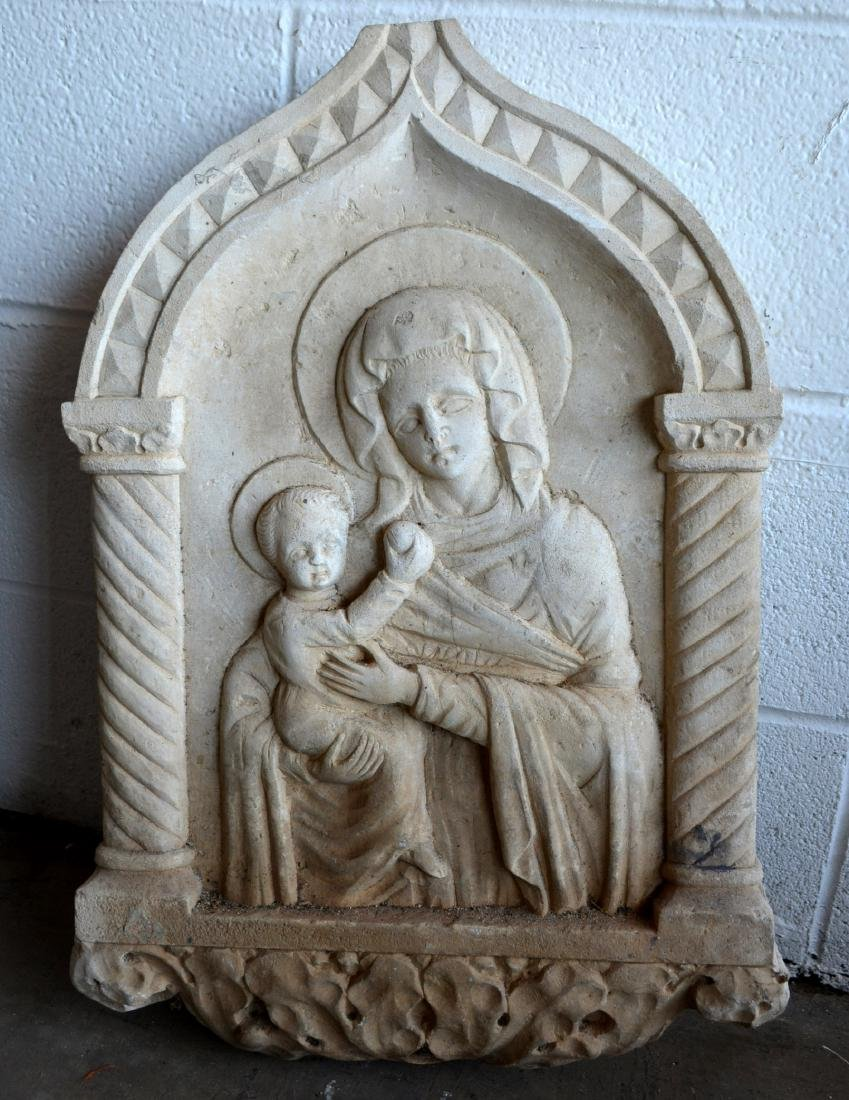 Carved stone religious rendering of Madonna & Child