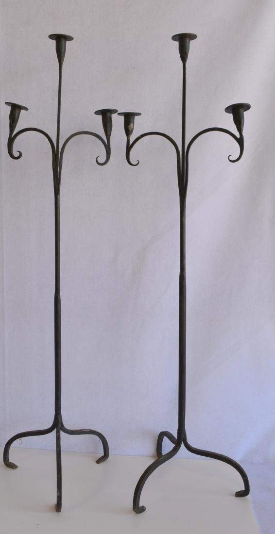 Pair of floor standing hand forged iron candelabras,