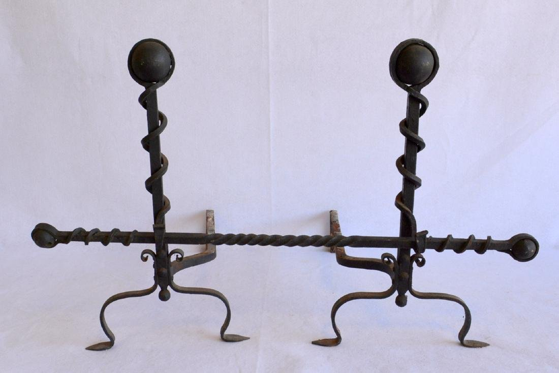 Pair of forged & cast iron Arts & Crafts andirons with
