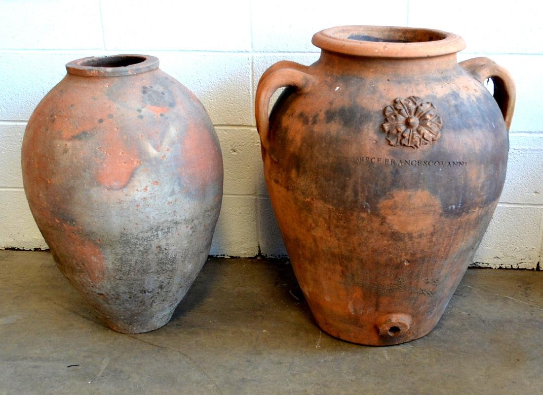 Two large Italian terra cotta water and olive jars: 1)