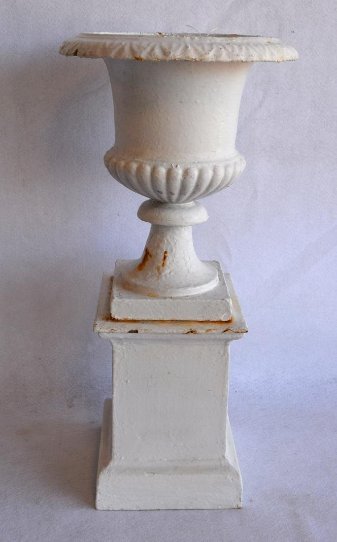 Small 2 part cast iron garden urn in layers of old