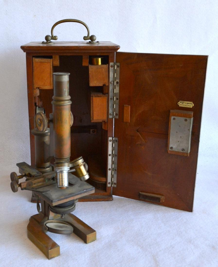 Brass microscope with 4 lens in original black walnut