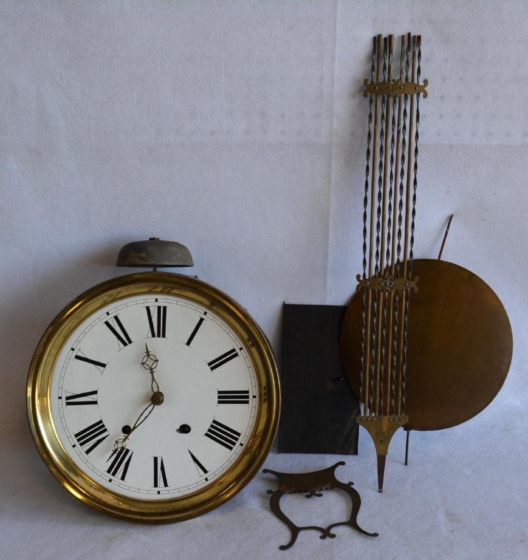French wag on the wall clock with enameled face and
