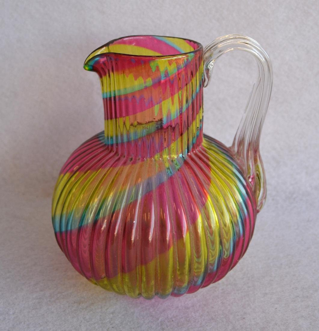 Art glass pitcher with applied handle ribbed rainbow