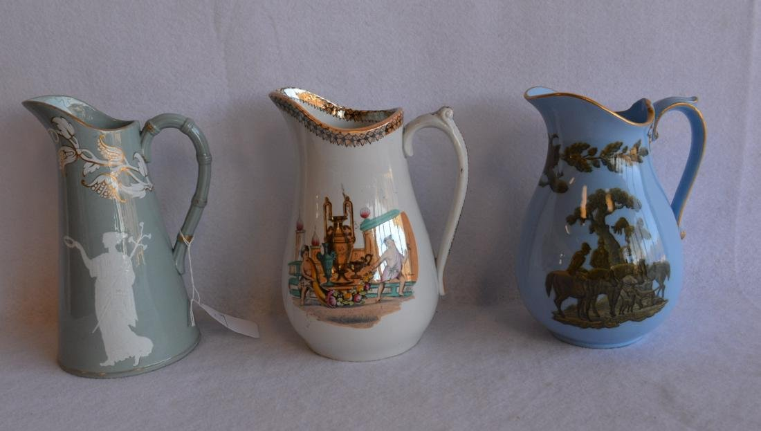 Three classical 19th century water pitchers - each