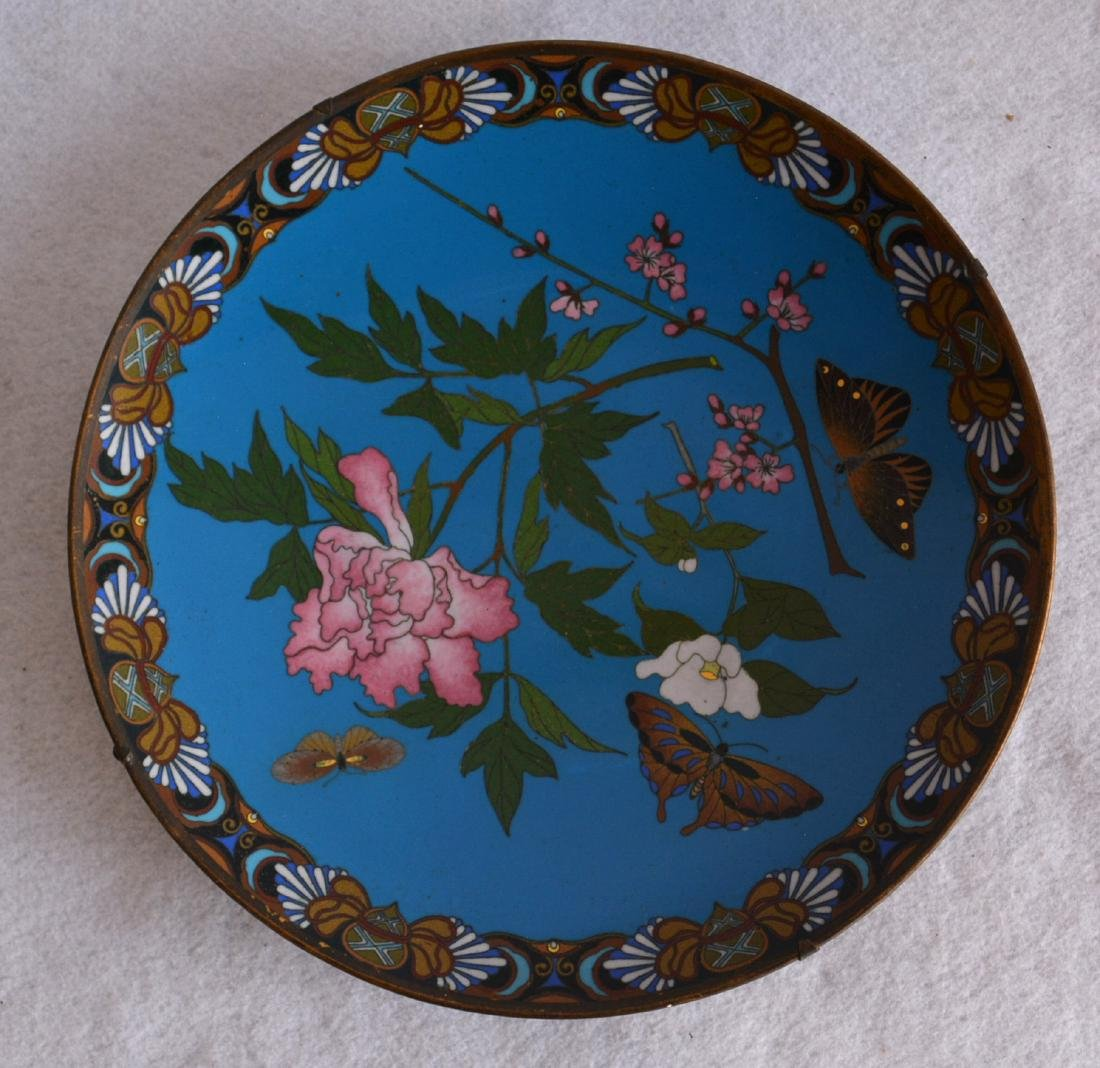 Cloissonne plate decorated with flowers and butterflies