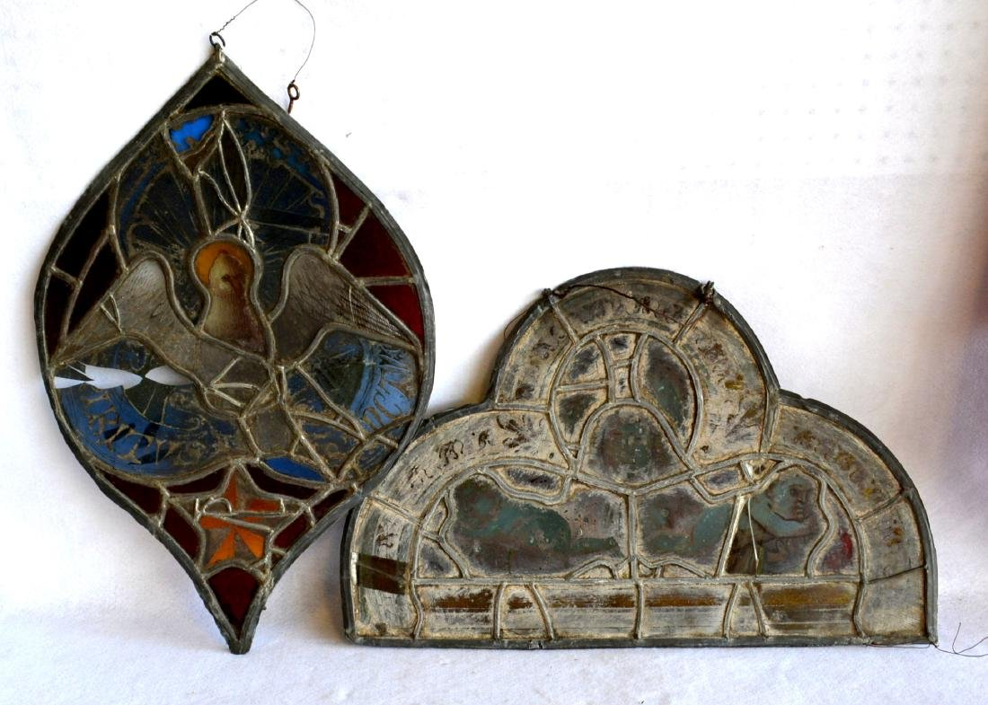 Two early shaped sections of leaded, stained and hand