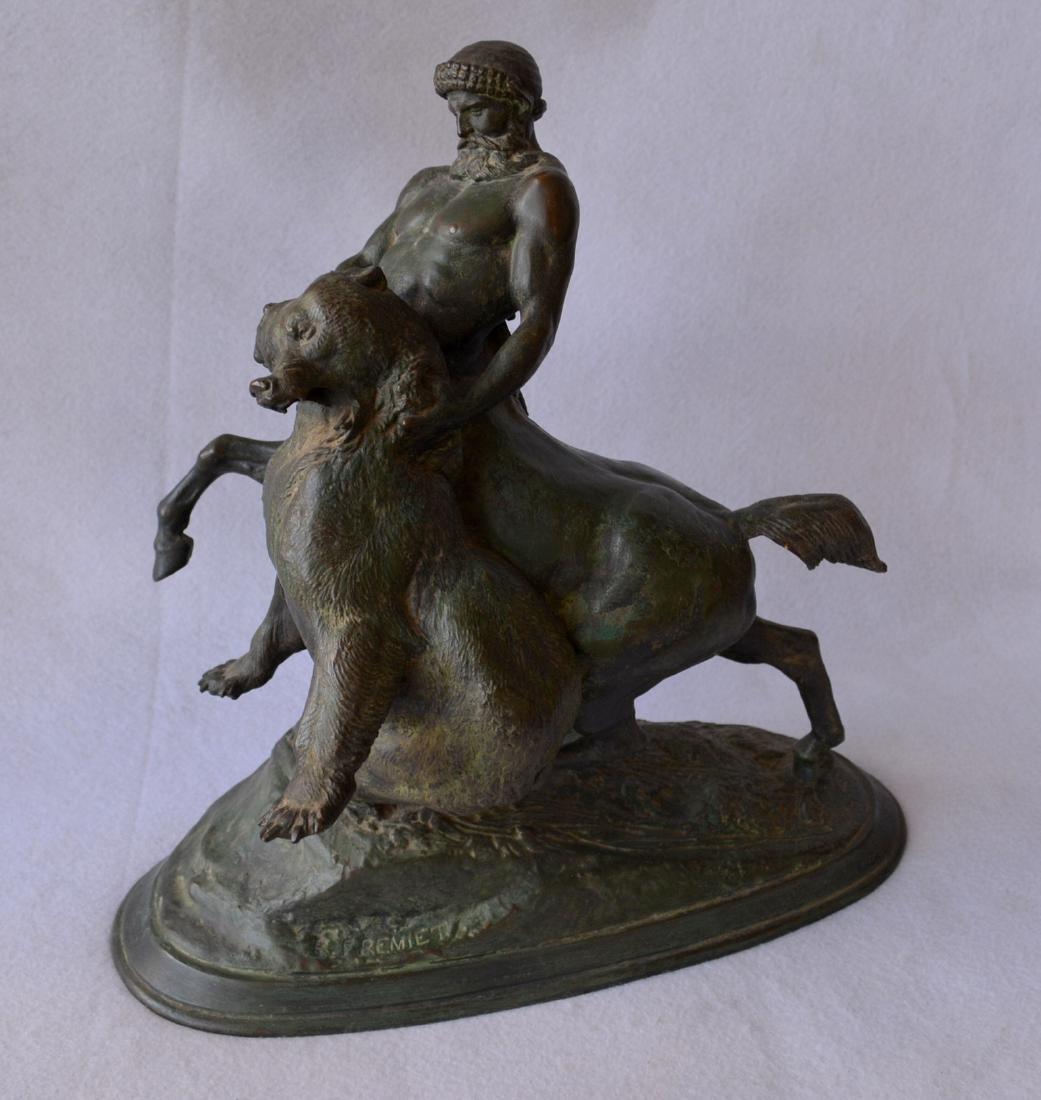 Bronze sculpture of a mythological centaur wrestling a