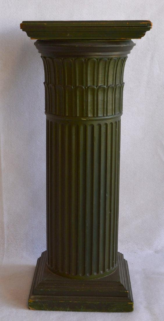A fluted wooden pedestal with a revolving  top –