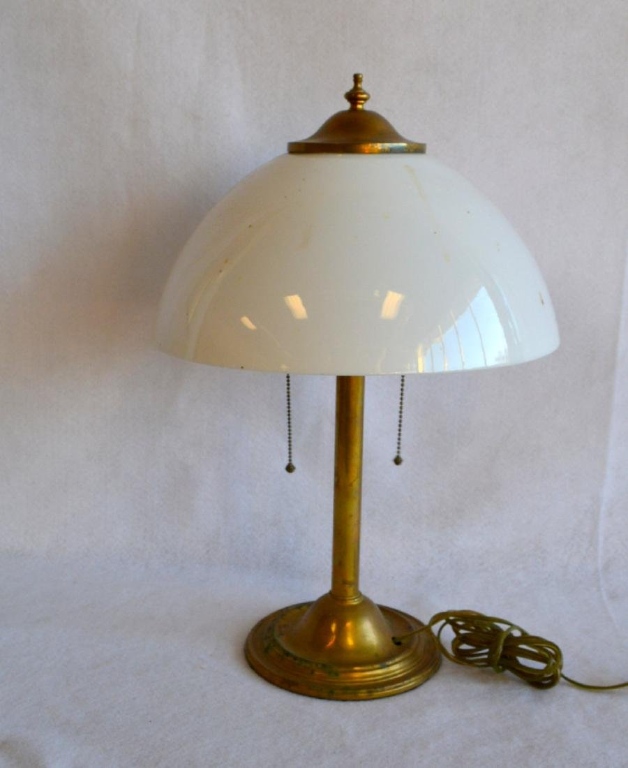 Brass clad table lamp with original opaque white glass