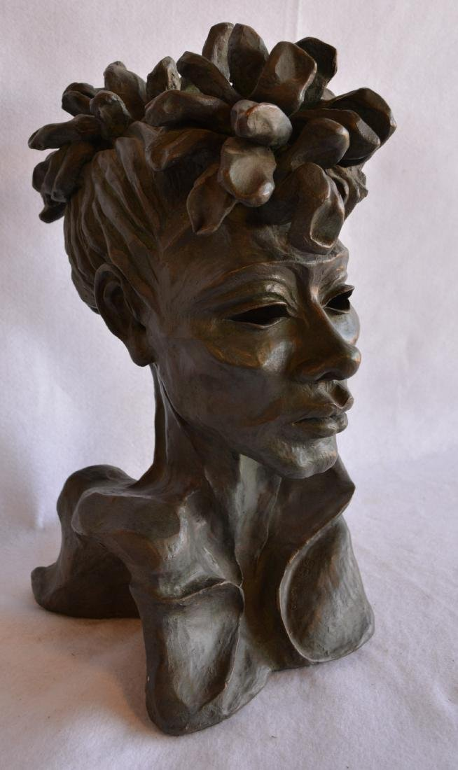 Plaster bust of an African American woman signed Carol