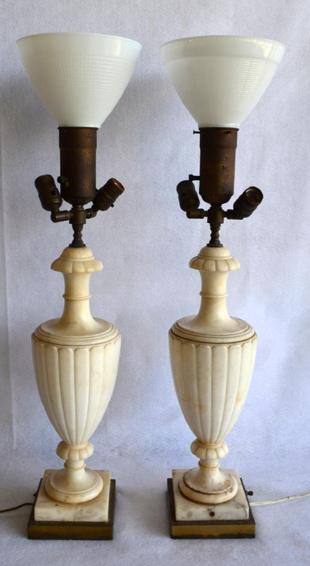 Matched pair of white marble table lamps, with urn